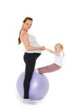 Happy family with fitness ball. Royalty Free Stock Image