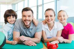 Happy family in fitness club. Stock Image
