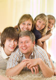 Happy family of five. On a light background stock photo