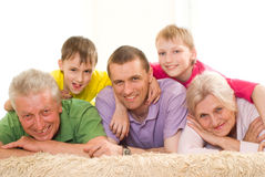 Happy family of five. Portrait of a happy family of five on a light background Stock Images