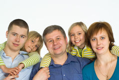 Happy family of five. Portrait of a happy family of five on white stock photography