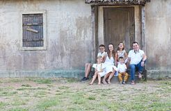 Family with five children outdoor near house stock photos