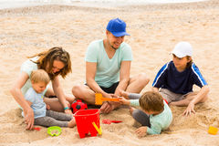 Happy family of five at sea shore Stock Image