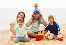 Happy family of five at sea shore Stock Photography