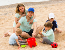 Happy family of five at sea shore Royalty Free Stock Photography