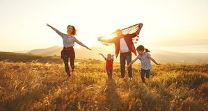 Happy family with flag of america USA at sunset outdoors Stock Photo