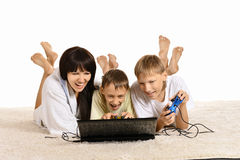 Happy family  on the floor with a laptop Stock Images