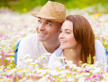 Happy family on flower field Royalty Free Stock Photos