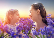 Happy family with flowers Stock Photography