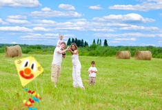 Happy family fly kite summertime Stock Photos