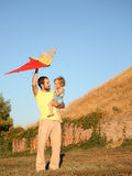Happy family flying a kite Royalty Free Stock Photo