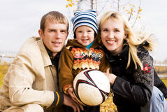 Happy family with a football ball outdoor Royalty Free Stock Images