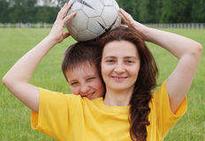 Happy family with football Stock Photos