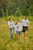 Happy Family in forest Stock Images