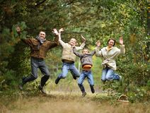 Happy Family in forest Stock Photos