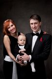 Happy family in formal dress Stock Photography