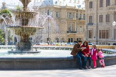 Happy family about the fountain Royalty Free Stock Images