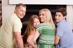 Happy family of four stock photos