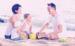 Happy family of four at beach Royalty Free Stock Photos