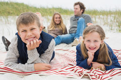 Happy family of four at a beach picnic Royalty Free Stock Photos