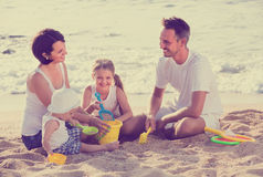 Happy family of four at beach Royalty Free Stock Images