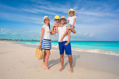Happy family of four on beach tropical vacation Stock Images