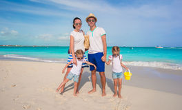 Happy family of four on beach tropical vacation Stock Photography