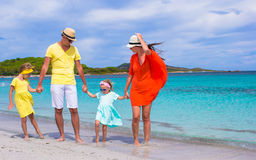 Happy family of four during beach vacation royalty free stock photography