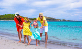 Happy family of four during beach vacation Royalty Free Stock Image