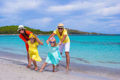 Happy family of four during beach vacation Stock Images