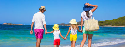 Happy family of four during beach vacation Royalty Free Stock Photos