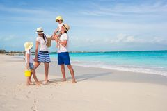 Happy family of four on beach vacation Royalty Free Stock Photo