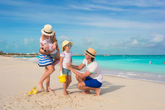 Happy family of four on beach vacation Royalty Free Stock Images