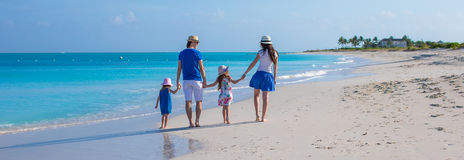 Happy family of four on beach vacation royalty free stock photos