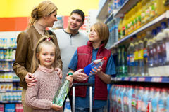 Happy family of four buying mineral water Stock Images