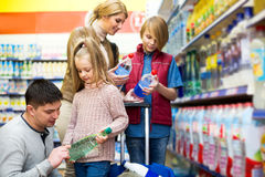 Happy family of four buying mineral water Royalty Free Stock Photography