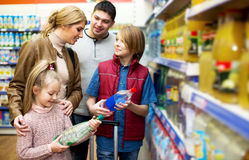 Happy family of four buying mineral water Royalty Free Stock Image