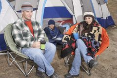 Happy Family Of Four Camping Together Stock Images