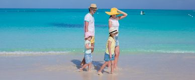 Happy family of four on caribbean holiday vacation Royalty Free Stock Photos