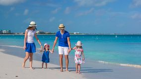 Happy family of four on caribbean holiday vacation Stock Photo