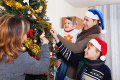 Happy family of four celebrating Christmas Stock Image