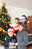 Happy family of four  with  Christmas tree Royalty Free Stock Photos