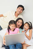 Happy family of four doing online shopping Stock Photo