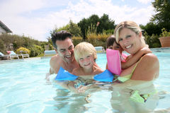 Happy family of four enjoying summertime holidays Royalty Free Stock Photo