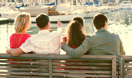Happy family of four enjoying  together near sea Royalty Free Stock Photo