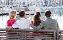 Happy family of four enjoying  together near sea Royalty Free Stock Image