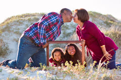 Happy family of four fun portrait outdoors. Royalty Free Stock Photography