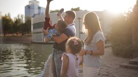 Happy family of four go out and have fun in the Park. stock footage