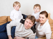 Happy family of a four having fun at home Stock Images