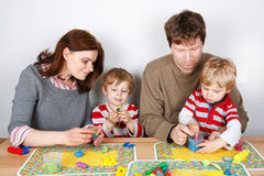 Happy family of a four having fun at home Royalty Free Stock Images
